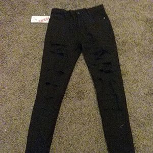 High waist black ripped Jean's and crooked top